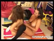 Cute girls play with a purple dildo